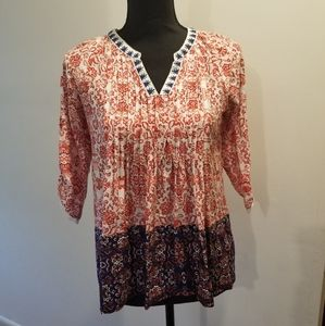 Patterned orange and navy blue blouse w 3/4 sleeve